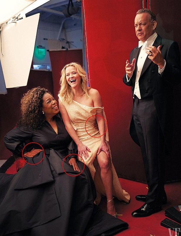 Detalhe de Oprah com as três mãos na imagem