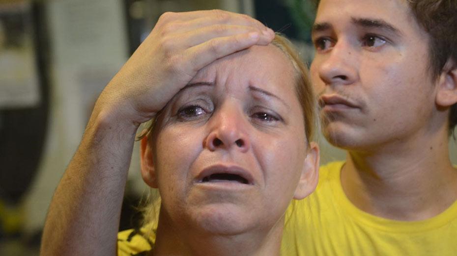 Elisângela dos Anjos e irmão mais velho da vítima